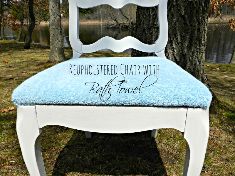 reupholstered chaire with bath towel