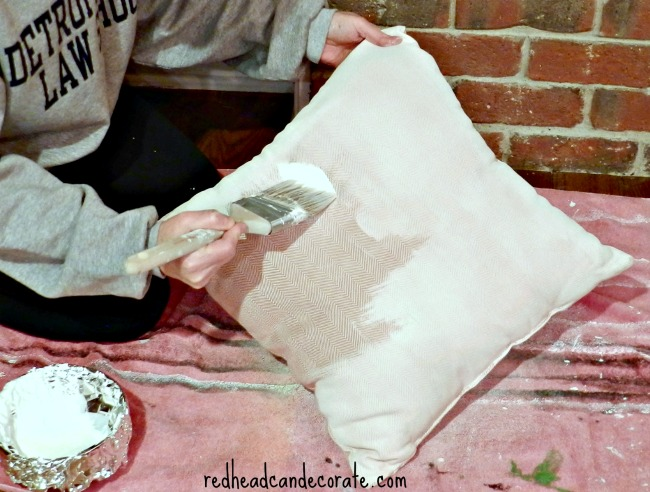 Transform an ugly pillow with paint.