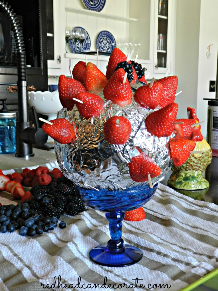 Wrap a foam ball in tinfoil and stick berries or other fruit in it for a fun festive (and healthy) appetizer at your next party.
