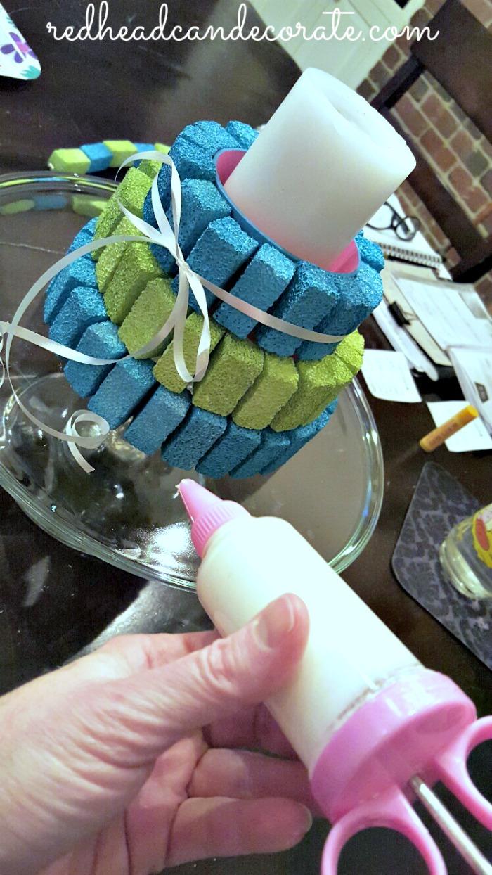 Decorating a fake cake!