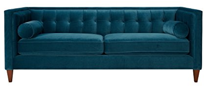 This teal blue velvet sofa is gorgeous! There are more colors, too!