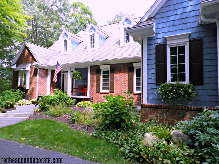 Did you know that you can put wood over old brick? This Budget Friendly Mahogany Wood Front Porch Makeover is so gorgeous!!