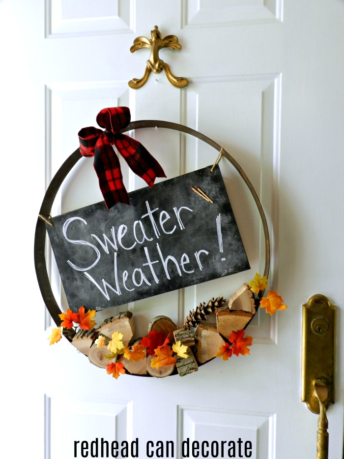 What a fantastic idea to turn a whiskey barrel hoop into a Fall wreath using some wood and other Fall decorations.