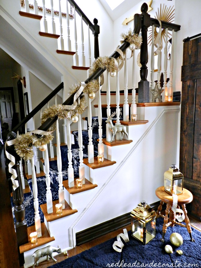 "This beautiful ""Blue & Gold Christmas Staircase"" was decorated easily using old fashioned gold garland and gold ribbon. The gold lanterns are the icing on the gold cake!"