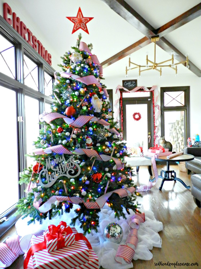 This Cotton Candy Cane Christmas Tree is so clever and cute! She used cotton balls for snowballs and the dollar store star floats above the tree!