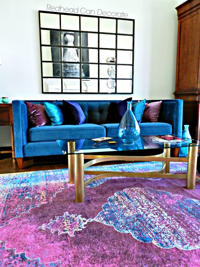 Transform Your Living Room with Vibrant Colors such as pink, purple, and blue! The pillow and rug sources are all listed.