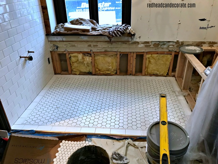 This Master Bathroom Renovation Tile Reveal is an amazing home improvement transformation. They saved the hardwood and the tile is stunning!