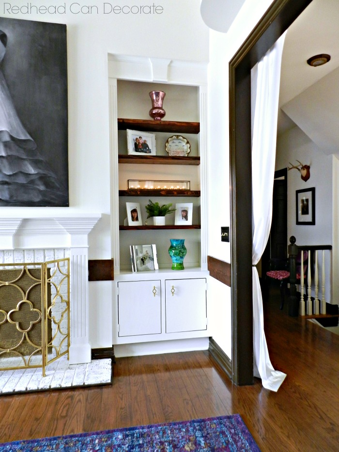 This Painted Built-In Shelves & Brick Fireplace makeover is truly shocking!