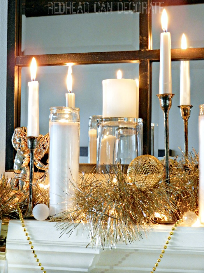 This mom blogger used dollar store candles for this Glamorous Christmas Mantel! She gives a full tutorial on how!