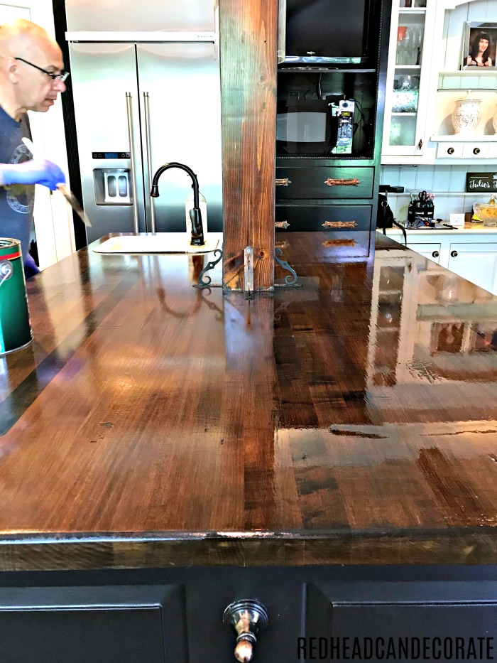 This DIY Refinished Butcher Block Kitchen Island is absolutely gorgeous, and she shares the products she used!