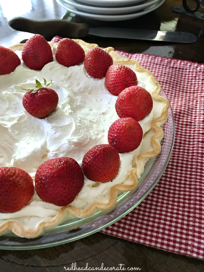 Creamy, sweet, light, fluffy, and a hint of cheesecake mixed with the flaky crust, and tart strawberries makes Redhead's Simple Strawberry Pie irresistible!