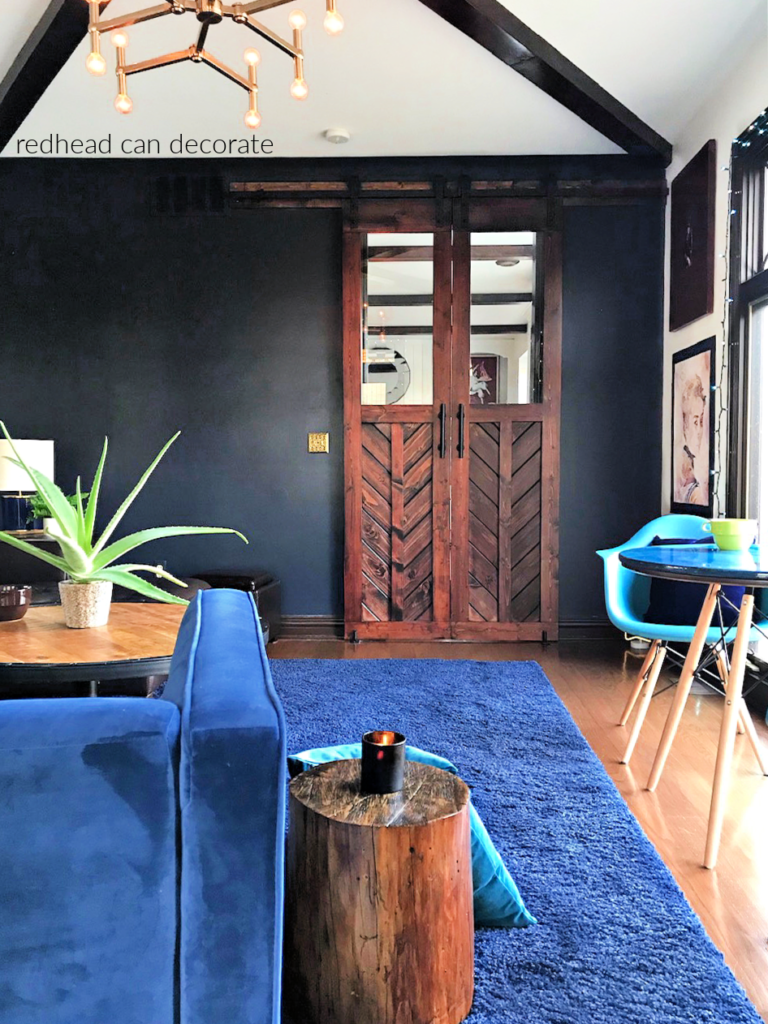 This gorgeous blue grey color looks amazing as a back drop in this beautiful family room (Zen Lounge Blue) a mom created during the pandemic to help her family relax.  The wood barn door is a must see!