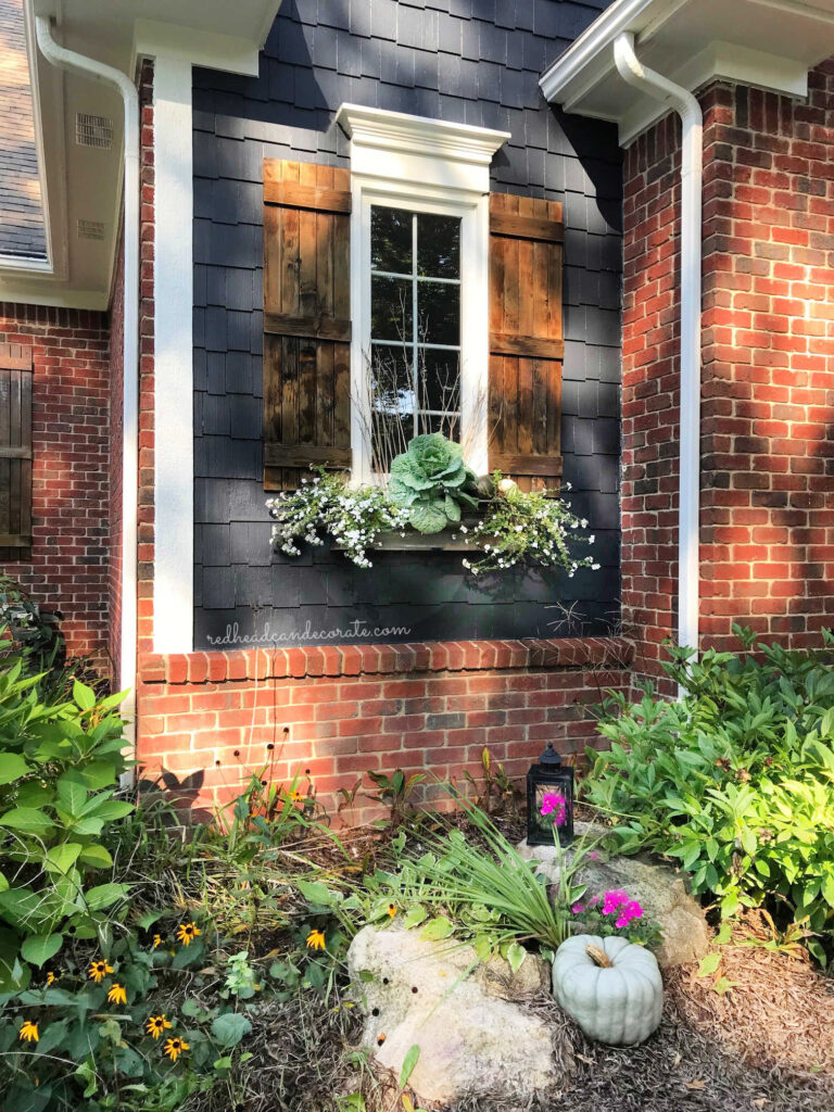 This beautiful Affordable Fall Ornamental Cabbage Window Box uses existing perennials to save money.  Just add the cabbage & pumpkins!